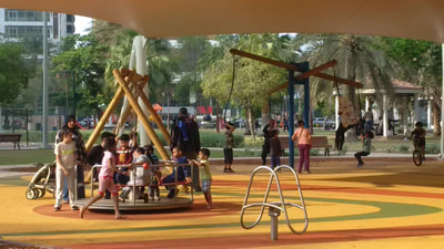 Municipal community park SAM Engineering eibe Germany play equipment wood swing carrousel