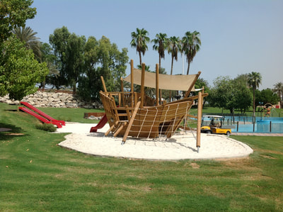 Commercial theme park SHUROOQ Al Montazah Park Sharjah UAE eibe wood pirate play ship Pinta wooden embankment slides