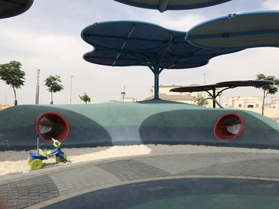 Abu Dhabi Municipality Community Park KCA eibe Germany play crawling tunnel