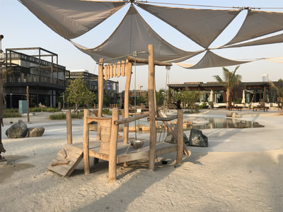 Semi Public Commercial Retail Park Cracknell Meraas Eibe Germany UAE United Arab Emirates natural play wood warm touch atmosphere authentic robinia Paradiso rope swing crawling climbing balance pyramid hide and seek beach sand building site