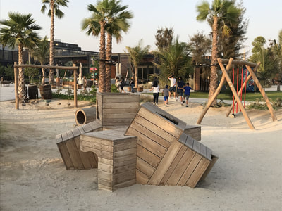 Semi Public Commercial Retail Park Cracknell Meraas Eibe Germany UAE United Arab Emirates natural play wood warm touch atmosphere authentic robinia Paradiso rope swing crawling climbing balance pyramid hide and seek beach sand